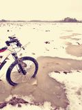 Mudd and water drops on bike tyre. Winter free ride in snowy landscape.  low temperature Stock Photography
