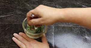 Muddling mint leaves with sugar in mortar and pestle, 4K stock video