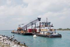 muddra flottörhus ny seaport för kran Royaltyfri Bild