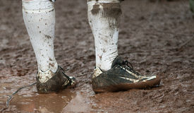 Muddy. Football Player standing in mud Royalty Free Stock Images