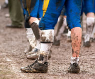 Muddy. Football Player standing in mud stock images