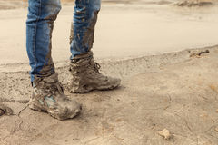 Free Muddy And Dirty Hiking Boots And Blue Jeans Royalty Free Stock Photography - 38811817