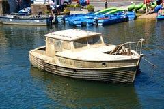 Muddy boat on the river, Wareham. Stock Photo