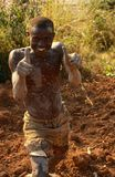A muddy brick worker in Rwanda. Royalty Free Stock Image