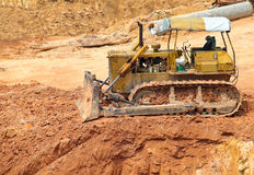 Muddy bulldozer at construction site Royalty Free Stock Images