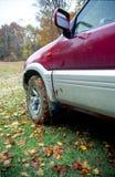 Muddy car in autumn Stock Images