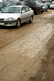 Muddy car parking Stock Photography
