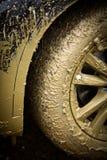Muddy car's wheel Royalty Free Stock Photos