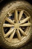 Muddy car's wheel Royalty Free Stock Photo