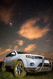 Muddy car with stars above Stock Image