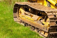 Muddy caterpillar tracks on bulldozer. Stock Image
