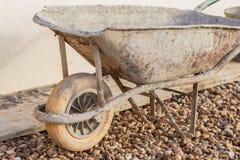 A muddy construction site wheelbarrow Stock Photography