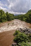 Muddy creek after heavy rainfall. Muddy Schoharie Creek waters after a heavy rainstorm in the Catskill mountains stock photo