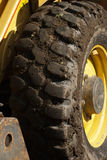 Muddy Digger Wheel with Yellow Trim Royalty Free Stock Photos