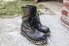 Black dirty boots royalty free stock images