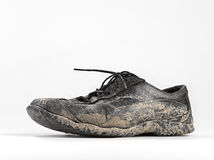 Muddy and dirty shoe Stock Photo