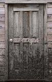 Muddy door. A mud covered door on a farm Royalty Free Stock Photography