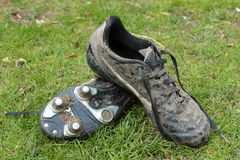 Muddy football boots Royalty Free Stock Image