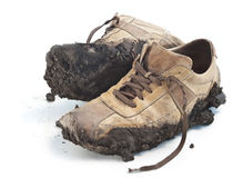 Muddy footwear shoes Stock Photo