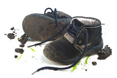 Muddy footwear shoes Royalty Free Stock Photo