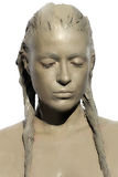 Muddy girl. Clay Woman. Skincare Treatment. Portrait of young woman covered in healing clay. Mud rich in minerals: calcium, magnesium, sodium, zinc, potassium Stock Photos