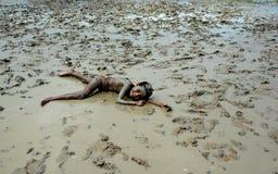 Muddy Girl. The girl enjoying herself on the muddy ground stock photo