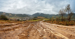 Muddy ground after rain in mountains. Extreme path rural dirt ro. Muddy ground after rain in Carpathian mountains. Extreme path rural dirt road in the hills Stock Image