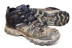 Muddy Hiking Boots Isloated Imagen de archivo libre de regalías