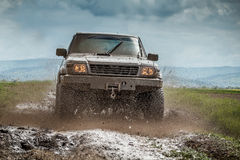 Muddy jeep. Very muddy jeep after off road driving stock image