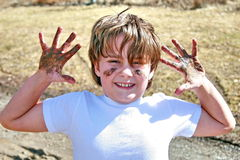 Muddy kid in the spring Stock Photo