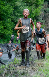Muddy kids run mudathalon Royalty Free Stock Images