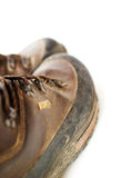 Muddy leather boots Stock Photography