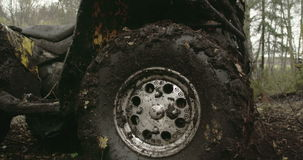 The muddy left wheel of the offroad vehicle FS700 4K stock video