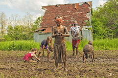 Muddy little boy wears goggles, country kids mud fight Royalty Free Stock Photo