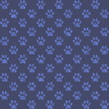 Muddy looking paw prints in middle blue Royalty Free Stock Image