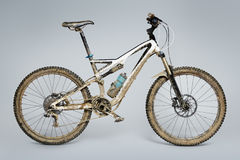 Muddy mountain bike Stock Photo