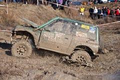 Muddy off-road. Off-Road Race held in Shumen, Bulgaria in December 2011. Competitor is Shumen - Nikolay Kolev navigator his son Michael Nikolov Stock Photo