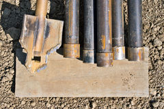 Muddy old auger with pipes Stock Photography
