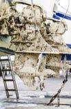 Muddy Outboard Motors Stock Photo