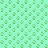 Muddy paw prints in green, dark on lighter Royalty Free Stock Photos