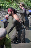 muddy people walking Stock Photography