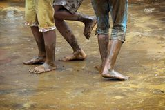 Muddy Playful Feet stock foto's