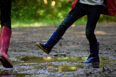 Children Playing in a Muddy Puddle royalty free stock photo