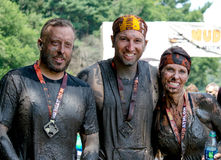 Muddy racers pose for a victory portrait Royalty Free Stock Photos
