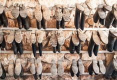 Muddy rain boots. Hanging with their soles up outside a stable royalty free stock photography