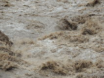Muddy Rapids. Close up of the Urubamab River in Cusco Peru during the rainy season Stock Photos