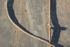 Muddy Rappelling Wall with Rope Stock Photography