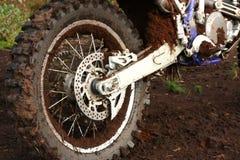 Muddy rear wheel of dirt bike Royalty Free Stock Images