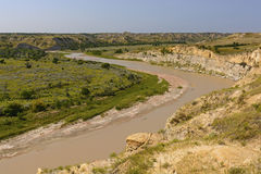 Muddy River in the Badlands Royalty Free Stock Image