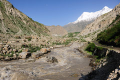 Muddy River & Nanga Parbat. Glacial muddy river and Mt. Nanga parbat seen from southeast Royalty Free Stock Photo